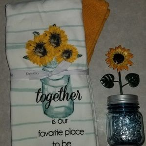 Kitchen towels and small sunflower jar